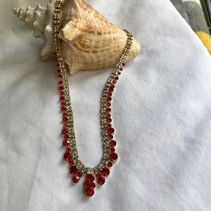 Red and clear crystal necklace set in gold tone